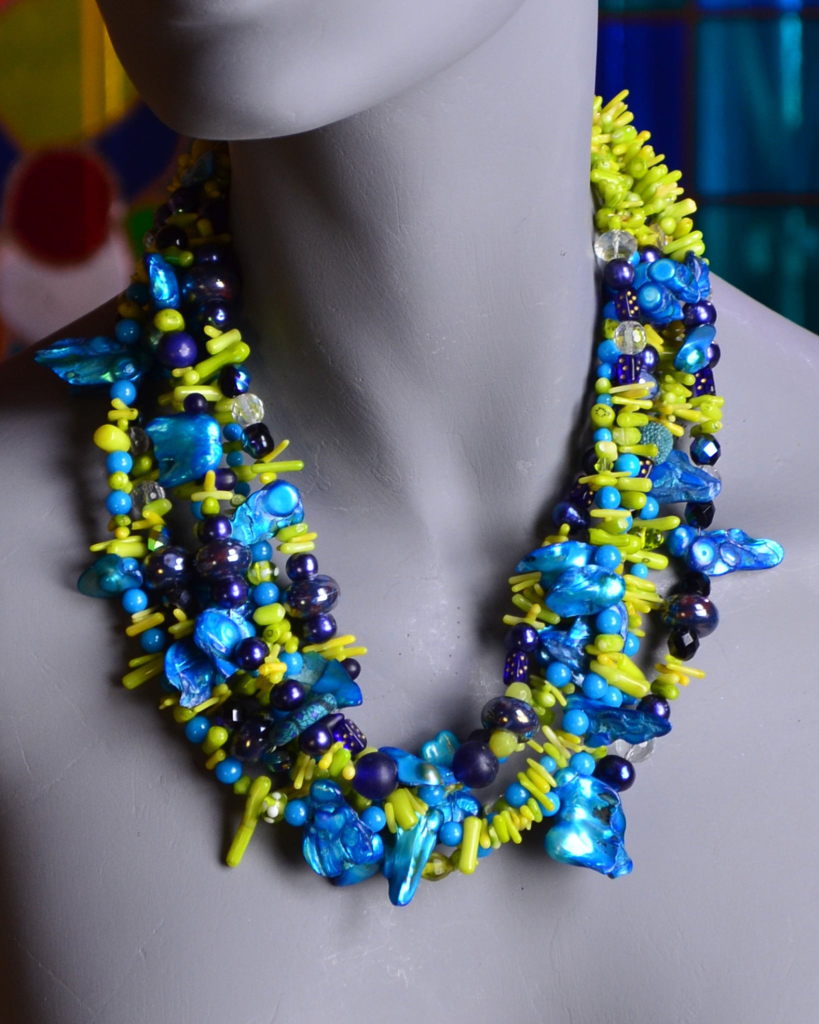 Six strands of shiny turquoise shell, navy lampwork, chartreuse chips of coral