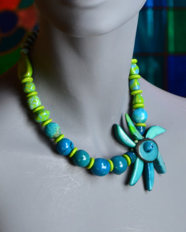 Tagua nut flower, blue and lime green Kazuri squares, and skies of natural turquoise and deep blue Tagua rounds
