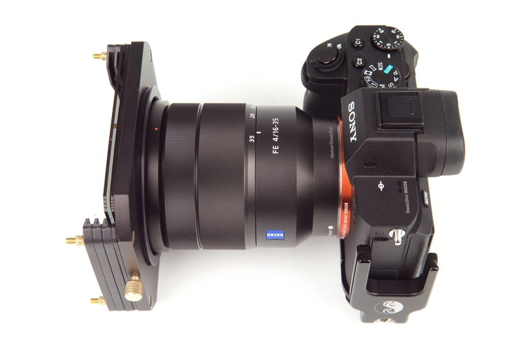 A top down view of a DSLR style camera with lens and Formatt Hitech filter holder system and filter attached to the front of the lens