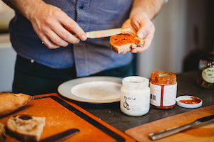 Spreading harissa on toast