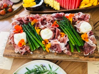 Prosciutto, asparagus and Burrata. Grazing table, seasonal produce