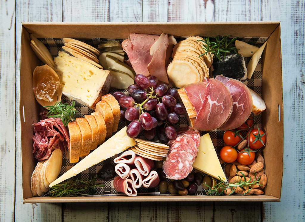 Delicious grazing box including cheeses, cured meats & grapes, nuts etc from their food platter range