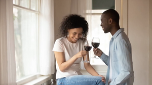 A couple enjoying wine while using the Sippin'It Wine Aerator Pourer