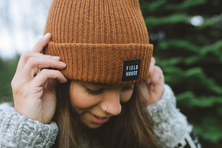 Field House brewing's brown acrylic toque with Field House patch sewn onto the front. Perfect to wear while sipping beer around the campfire.Photo taken in Abbotsford BC.
