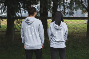 Field House Brewing's heather grey premium French Terry full zip hoody with East Abby printed on the left chest and Field House Brewing logo on the back in white. Photo taken at Field House Farms in Abbotsford BC.