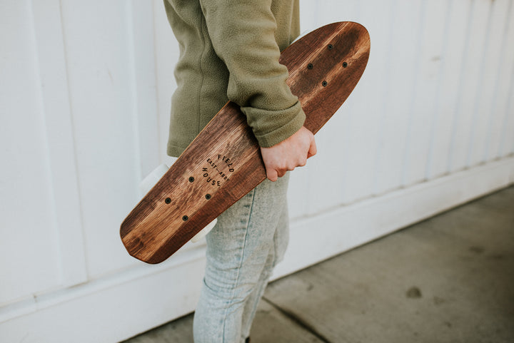 Red wine stained Penny boards made locally from red wine barrels with Field House East Abby logo laser engraved on the top. Photo taken at Field House Brewing in Abbotsford BC.