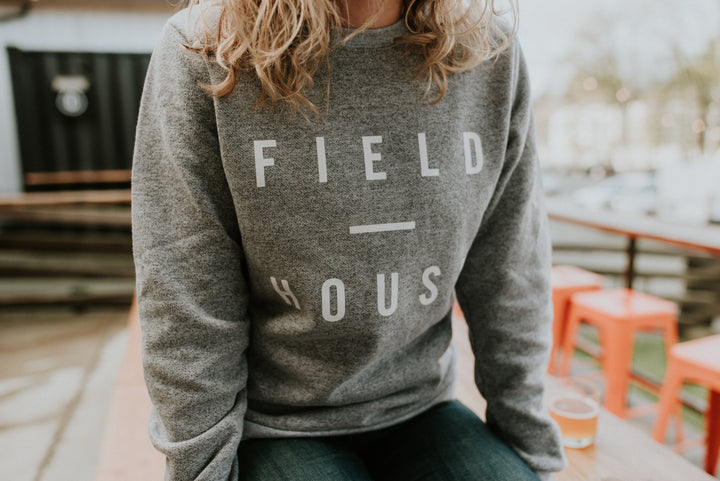 Field House Brewing's heather grey crewneck with Field House printed in white on the front. Photo taken in Abbotsford BC.