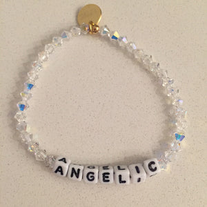 "Picture of bracelet it says, ""ANGELIC"", and has clear Swarovski crystals beads."