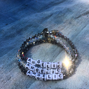 Both the two colors ANGELIC bracelets, in black and white crystals.
