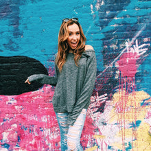Load image into Gallery viewer, Front of Cozy Comfy Crewneck (grey crewneck), worn on a 20-year-old standing in front of a colorful wall.