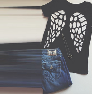 Flat lay picture of our Cut To A Tee V-Neck, with jeans and a necklace on the, too.