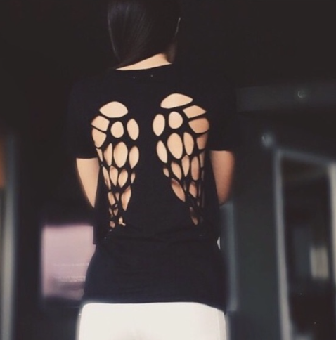 Picture of Cut To A Tee Black Shirt. It is a V-neck with laser cut angel wings on the back.