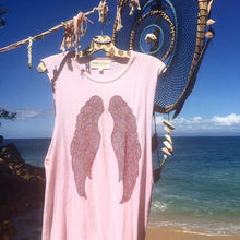 Load image into Gallery viewer, Pink tank top with red wings handing over the beaches in Mexico.