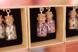 7PLIS recycled skateboard chip earring, glass vial and multicolor black green blue pink