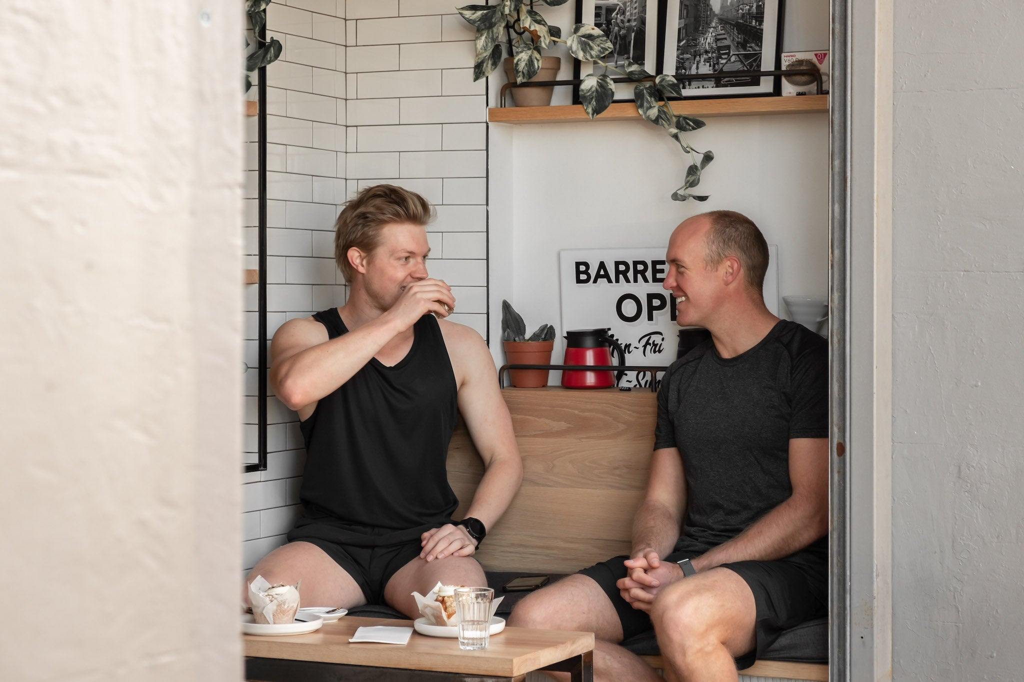 Two men having a conversation and coffee at Barrel One in Manly, Sydney