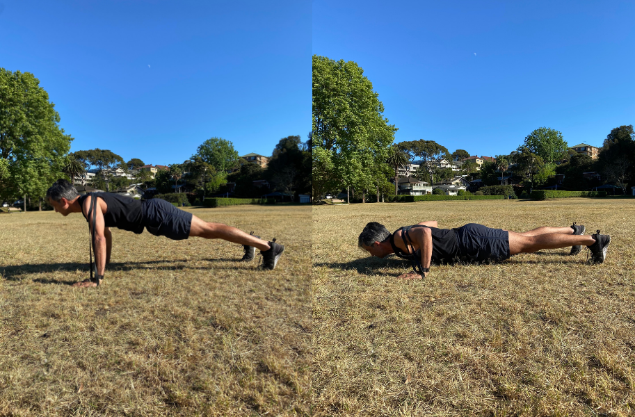 Man doing push ups with a resistance band