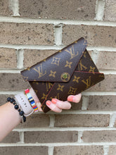 Load image into Gallery viewer, Louis Vuitton Kirigami Medium monogram pouch with red interior