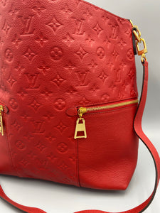 Louis Vuitton Melie Empreinte Monogram red with strap