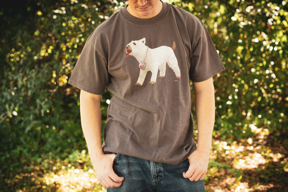 Man wearing a vintage t-shirt with picture of a dog in full body cast from the movie There's Something About Mary.