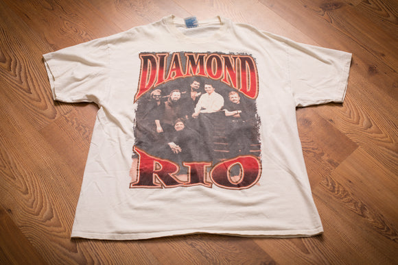 vintage 90s t-shirt with rio diamond text and photo of the country music band