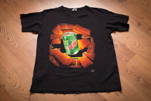 vintage 90s black t-shirt with graphic of mountain dew can breaking through a brick wall