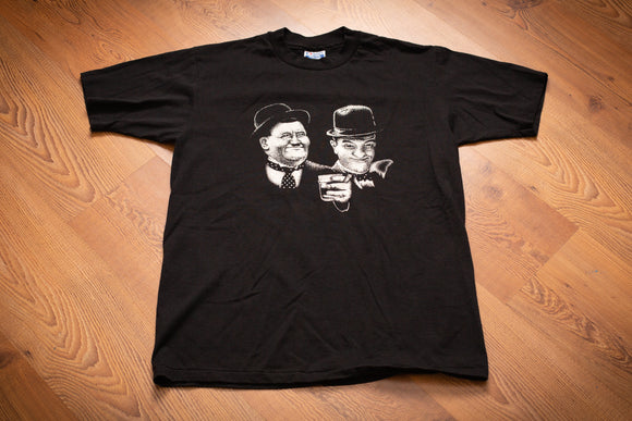 vintage 90s black t-shirt with graphic of laurel and hardy