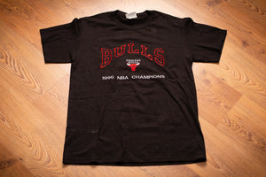 vintage 90s black t-shirt with embroidered chicago bulls text and logo and 1996 nba champions text