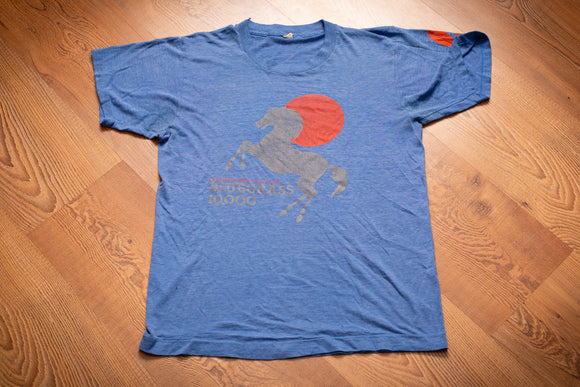 vintage 80s blue t-shirt with stallion graphic and text for the 1985 Bluegrass 10000 race