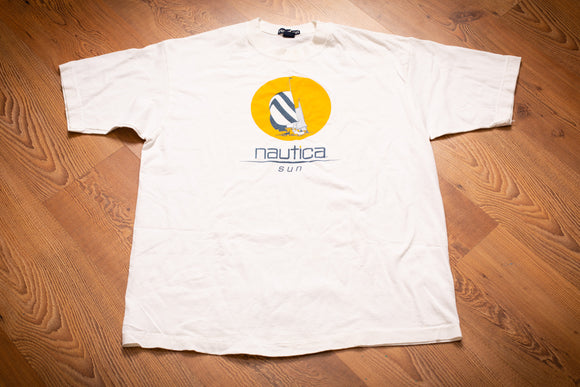 vintage 90s white t-shirt with nautica brand text and sailboat and sun graphics