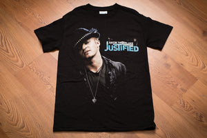 Genuine 2003 black t-shirt with Justin Timberlake in black hat and text promoting his Justified tour