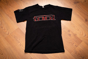 black t-shirt with the rock band tool's logo