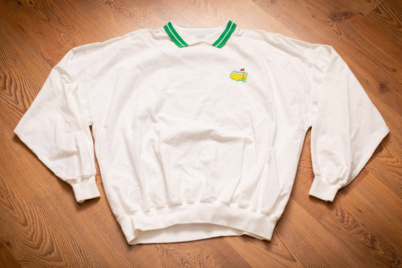 vintage 90s white polo shirt with embroidered masters golf tournament logo