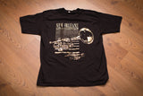 vintage 80s black t-shirt with gold foil trumpet and new orleans birthplace of jazz text