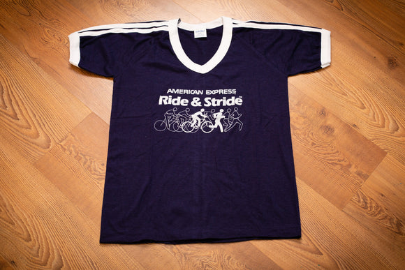 vintage 70s-80 blue t-shirt with american express and ride and stride text along with graphic of people biking and running