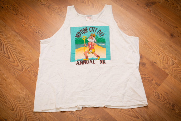 vintage 90s tank top with graphic of neptune roman god of the sea cartoon graphic and text of neptune city day annual 5k