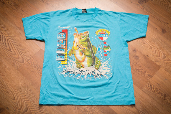 vintage 80s to 90s teal t-shirt with colorful text and graphics of a largemouth bass jumping out of water to bite a fishing lure