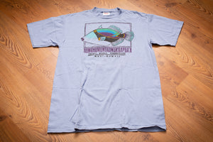 vintage 90s light blue t-shirt with Humuhumunukunukuapua'a fish graphic and Pacific Whale Foundation text