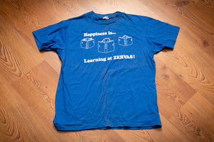 vintage 70s to 80s blue t-shirt with happiness is learning at zervas text and graphics of children reading school books