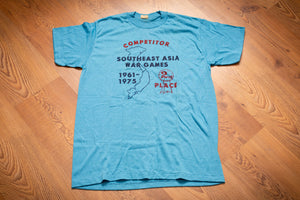 vintage 70s blue t-shirt for vietnam war veteran with text reading competitor southeast asia war games 1961-1975 2nd place