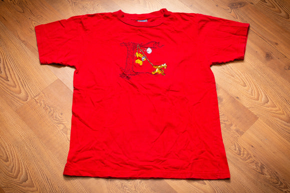 vintage 90s red t-shirt with embroidered graphics of winnie the pooh and tigger trying to get honey from a beehive in a tree