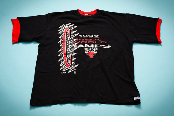 Vintage 1990s black t-shirt with red collar and sleeve ends with text and logo celebrating the Chicago Bulls 1992 NBA Championship
