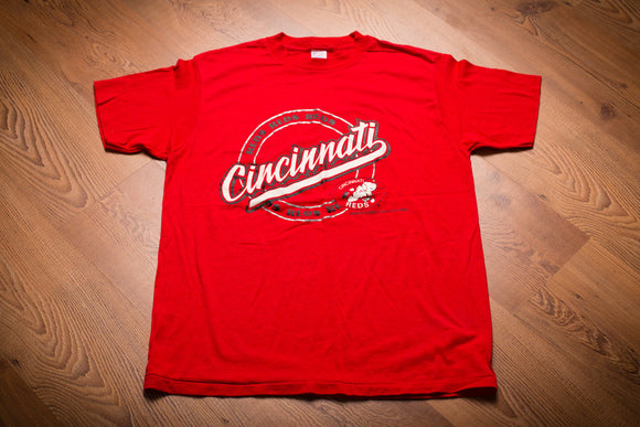 Vintage 1980s red t-shirt with Cincinnati script and Cincinnati Reds' logo on it