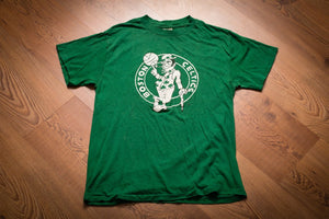 Vintage 80s green t-shirt with classic Boston Celtics logo