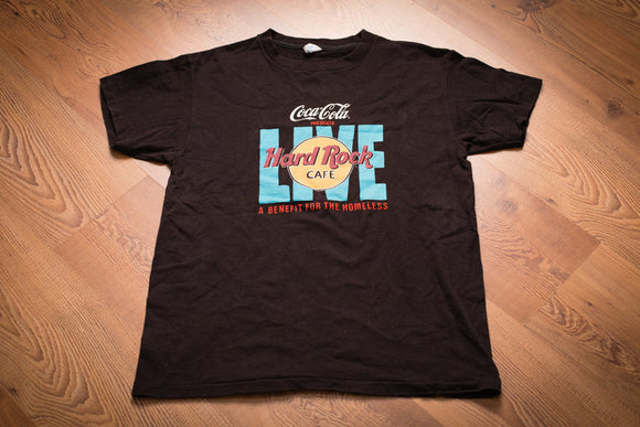 Vintage 80s black t-shirt with Coca-Cola and Hard Rock Cafe logos promoting a benefit for the homeless in New York City