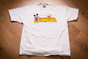 vintage 90s white t-shirt with mickey mouse leaning on large florida text and walt disney world resort text