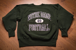 Vintage 80s to 90s green sweatshirt Notre Dame Football text and ND logo