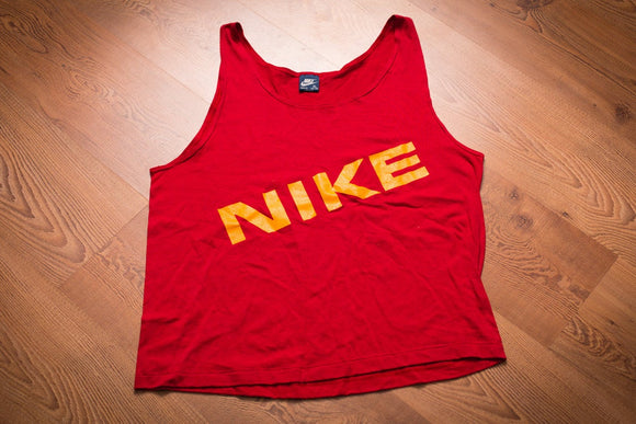 vintage 80s red tank top with yellow nike spellout text