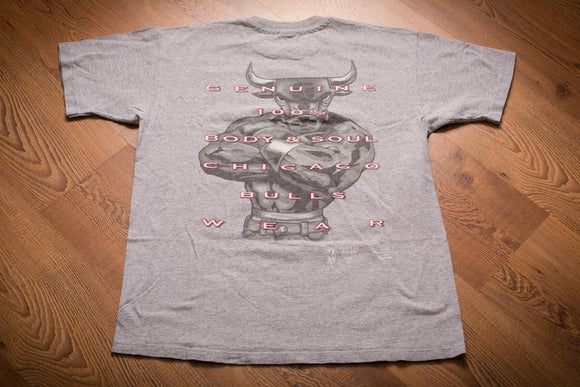 vintage 90s gray t-shirt with chicago bulls text and a muscular bull graphics