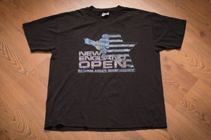 Black t-shirt with graphic of star and martial artist doing a flying kick and New England Open National Karate Championship text