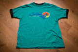 vintage 80s teal t-shirt with sea trek text and graphic of scuba divers and a sun